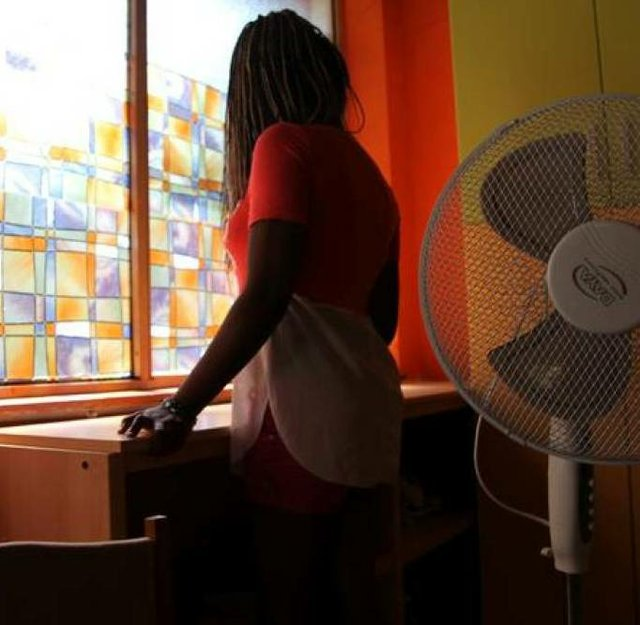 "Nigerian ex-prostitute ""Beauty"" (a pseudonym), poses in a social support centre for trafficked girls near Catania in Italy September 14, 2016"