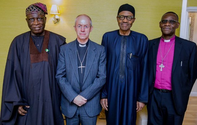 Buhari poses with (from left) Nigeria's High Commissioner to the UK - Ambassador Oguntade, Archbishop Welby and Archbishop Idowu-Fearon