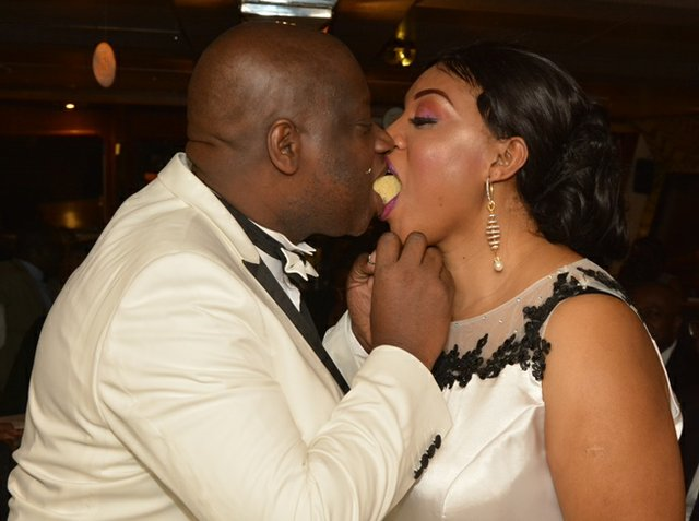 Adeyinka feeding  his wife - Olubunmi b.jpg