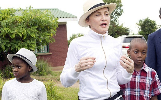 Madonna, centre, tours the Mphandura orpahange near Lilongwe, Malawi