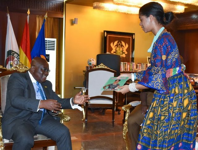 Zuriel presents book to President Akufo-Addo