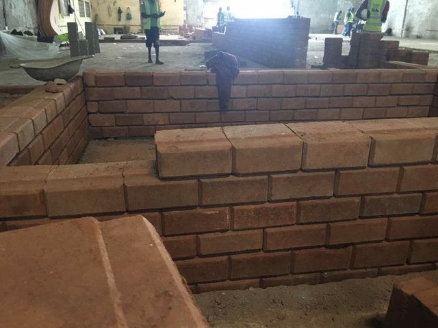 A site under construction with laterite bricks