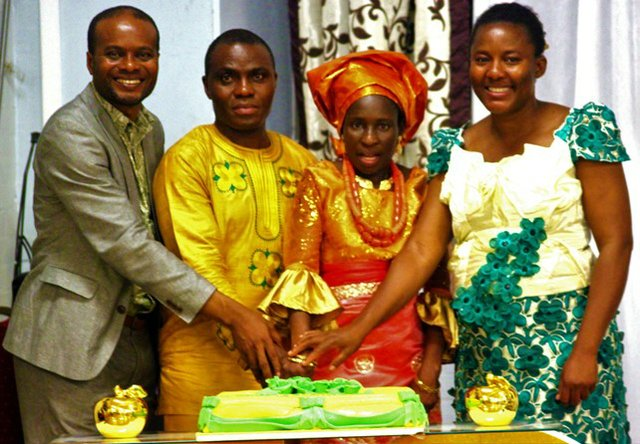 Evang VeraLove and SteveDeRock pose with the celebrant and her husband b.jpg