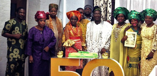 Members of the COP branch of the Christ Apostolic Church with the celebrant b.jpg