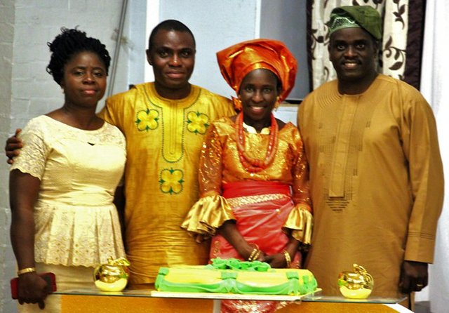 Mr & Mrs Gbenga Okutubo pose with Mr & Mrs Olubanjo b.jpg
