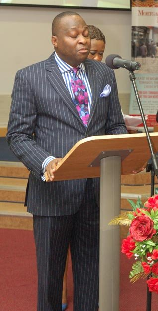 Pastor Leke Sanusi offering the Opening Prayer.jpg