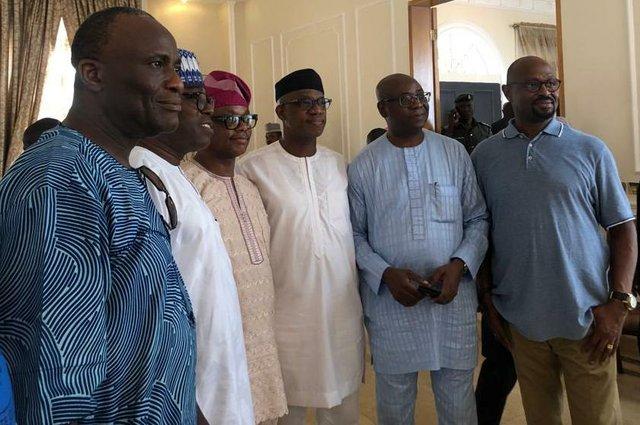 Friends including Lawal Owonifari (3rd left) and Kayode Sogbetun (far right) rejoicing with Abiodun.jpg
