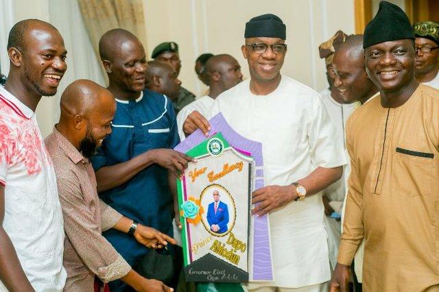 Journalists present a Congratulatory card to Abiodun.jpg