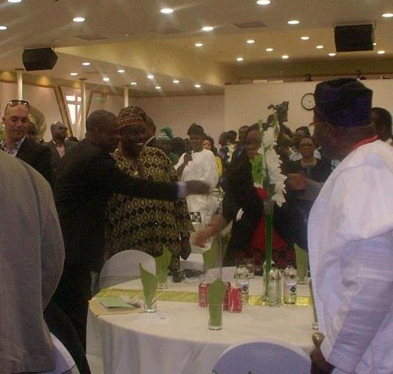 Senator Ibikunle Amosun shaking hands with guests including Femi Okutubo and Jumoke Ariyo.jpg
