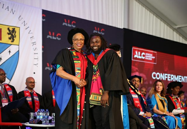 Graça Machel congratulates an ALC graduate from the Class of 2015