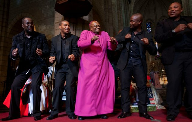 Tutu celebrating Templeton Prize win with members of the Cape Town Opera Voice of the Nation Ensemble