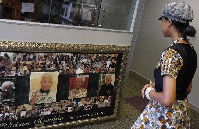Zuriel admires a Nelson Mandela montage