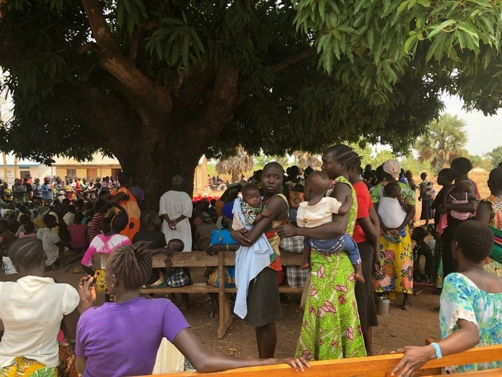 Displaced civilians holding a meeting under a tree in Yei, South Sudan