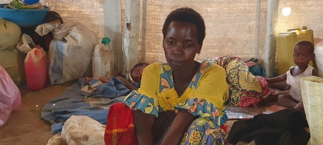 A newly-displaced woman in a displacement site in Bunia town, DRC