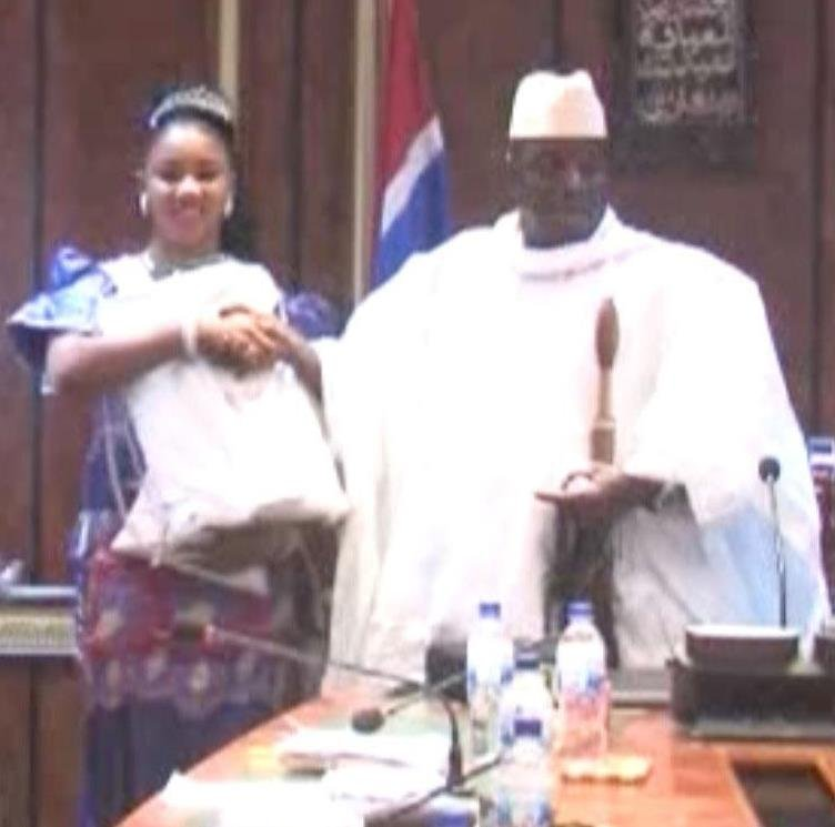 Fatou (Toufah) Jallow receiving award from President Jammeh as winner of the Miss July 22 Pageant in 2014