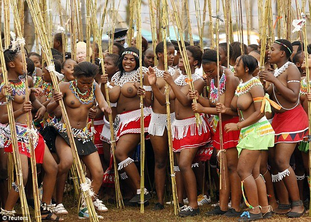 Culture: The Reed Dance ceremony, pictured, is known as Umhlanga