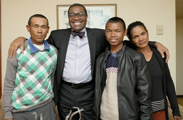 Akinwumi A Adesina poses with Anthony's family