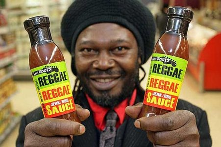 Levi Roots proudly shows off his Reggae Reggae Sauce