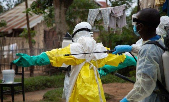 Rinsing Ebola protective gear in Beni, Democratic Republic of the Congo