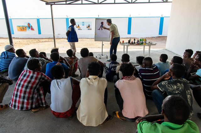 Migrants at the MRC participate in a social activity aimed at raising awareness on the risks and dangers of irregular migration