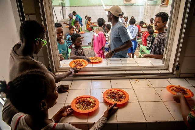 With support from IOM, street children in Djibouti city are hosted at Caritas and receive hot meals