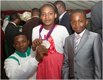 Anthony Ulonnam  silver medalist in the 56kg mens category with 2 young Nigerians.jpg