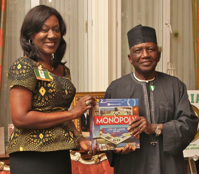 Mrs Nimi Akinkugbe, CEO Bestman Games presenting The City Of Lagos Edition of Monopoly to H.E Dr Dalhatu Sarki Tafida CFR, Nigeria's High Commissioner to the UK