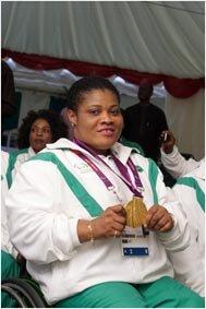 Gold Medalist Loveline Obiji Nigeria s 82.50kg power-lifter.jpg