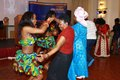 An ICSN member teaching a guest unique dance steps.JPG
