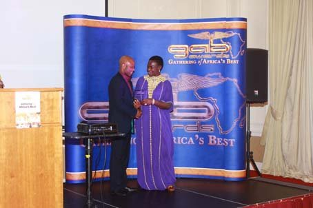 Ayan DeFirst receiving the award from the Mayor of Enfield - Cllr Kate Anolue.JPG