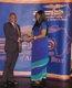 Fatima Jabbe presenting GAB Award to Club 87 s Dr Henry Okosun.JPG