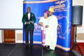 Mr Babatunde Loye after receiving his award from Mr & Mrs Mike Abiola.JPG