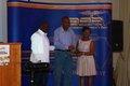 Mr Segun Oyebolu (middle) receiving his award from Mr Dele and Mrs Esther Ogun.JPG