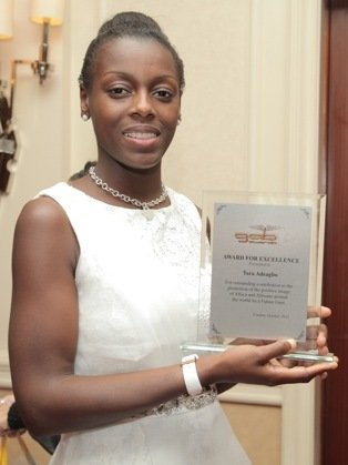 Tara Adeagbo shows off her award plaque
